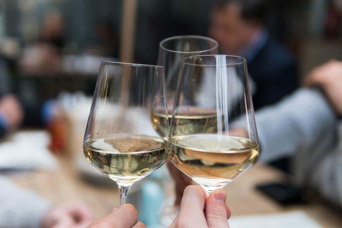 three glasses toasting.